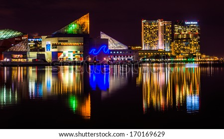 The Legg Mason Building and National Aquarium at night, in the Inner Harbor of Baltimore, Maryland. - stock photo