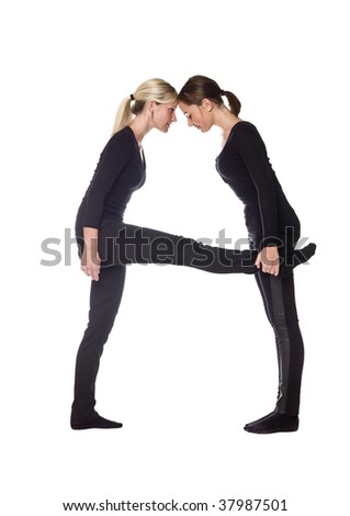 The letter 'A' formed by people dressed in black - stock photo