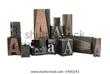 the letter A in both wood and metal type in different sizes and fonts, isolated on white - stock photo