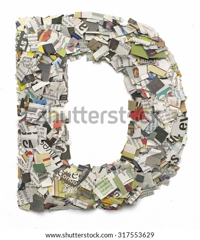 The letter D  made from newspaper confetti - stock photo