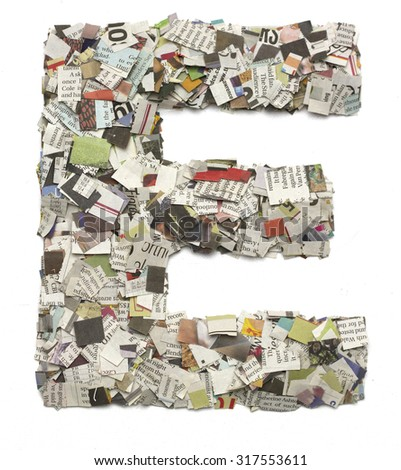 The letter E  made from newspaper confetti - stock photo
