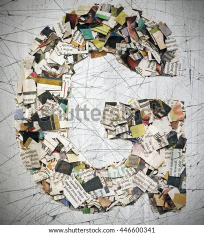 The letter G  made from newspaper confetti - stock photo