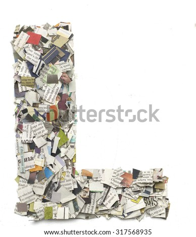The letter  L  made from newspaper confetti - stock photo