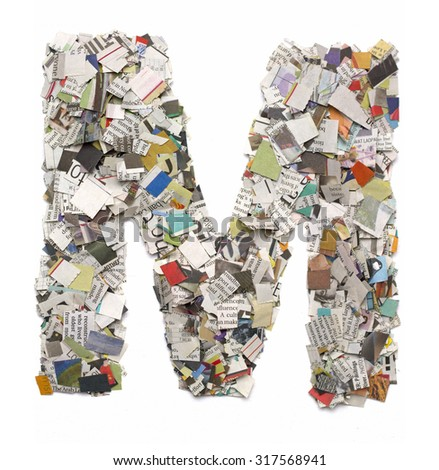 The letter  M  made from newspaper confetti - stock photo