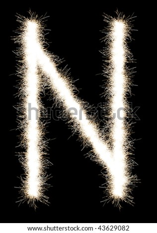 The letter N from a Bengal fire, on a black background, it is isolated.