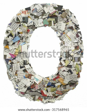 The letter O  made from newspaper confetti - stock photo