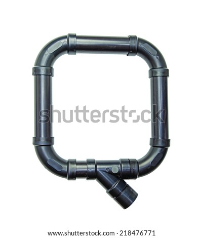 The letter Q created out of multiple pieces of plastic drain pipe. - stock photo