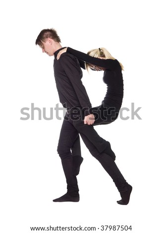 The letter 'R' formed by people dressed in black - stock photo