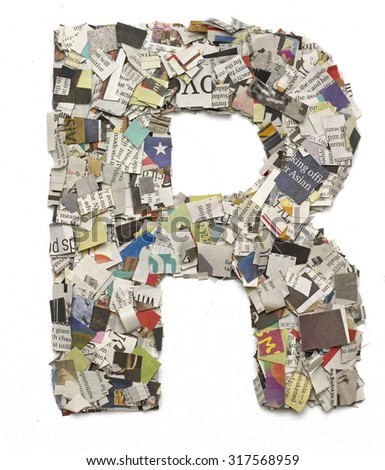 The letter R  made from newspaper confetti - stock photo
