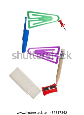 The letter 'S' made of office supplies isolated on white