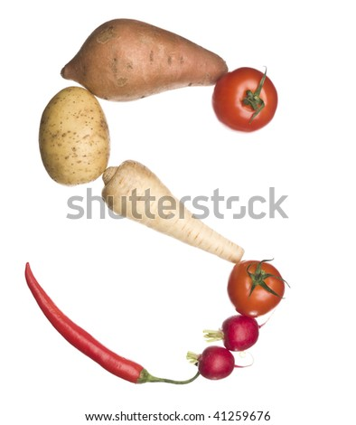 The letter 'S' made out of vegetables isolated on a white background