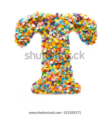 The letter T is laid out colored confetti. White background.