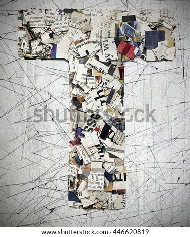 The letter  T  made from newspaper confetti - stock photo