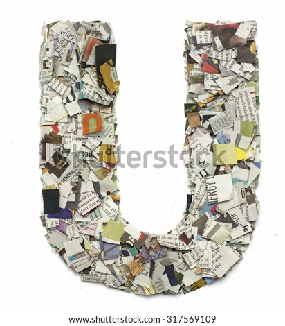 The letter  U  made from newspaper confetti - stock photo