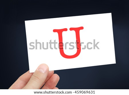 The letter U on a card
