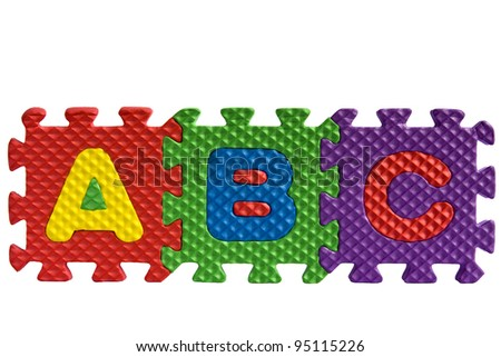 The letters ABC written with alphabet puzzle letters isolated on white background - stock photo