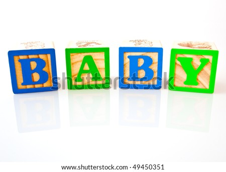 the letters b a b y spelling baby with wooden blocks