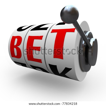 The letters in the word Bet line up for a jackpot on 3 slot machine wheels, symbolizing a jackpot of wealth, money, riches - stock photo