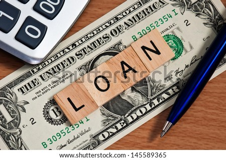 The letters LOAN on  dollar banknote business concept - stock photo