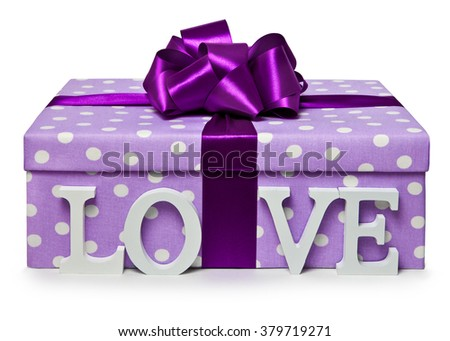 The letters love are near gift boxes with bowknot - stock photo