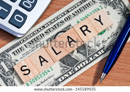 The letters SALARY on  dollar banknote business concept - stock photo