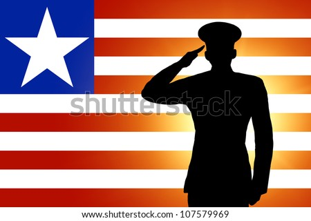 The Liberian flag and the silhouette of a soldier's military salute - stock photo