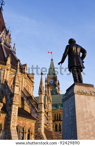 The Library, Peace Tower and statue of Thomas D'arcy McGee on Parliament Hill in Ottawa Canada. - stock photo