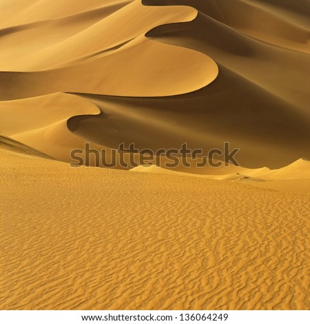 The Libyan desert - a fantastic place for travelers and photographers. Beautiful structure of dense yellow sand, dune of the huge sizes. - stock photo