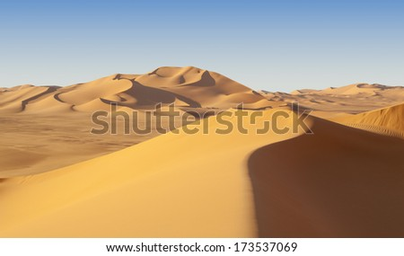 The Libyan desert - a fantastic place for travelers and photographers. Beautiful structure of dense yellow sand, dune of the huge sizes and deep sky of Sahara. - stock photo