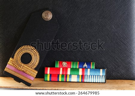 The lieutenant junior grade navy arm uniform put beside badge band decoration represent the Royal Thai Navy uniform concept related idea.   - stock photo