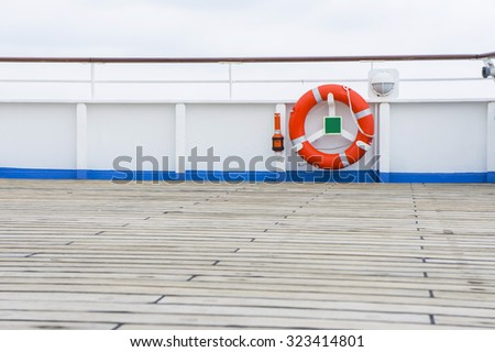 The lifebuoy on the cruise deck - stock photo