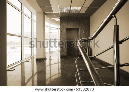 The lift and the big window in modern hotel - stock photo