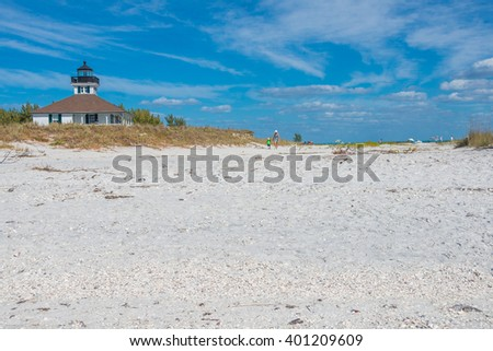 The Light at Boca Grande Beach on Gasparilla Island, in southwest Florida.  A popular beach for sun, surf and sand and known for its sugar sand beaches, shelling, blue water and world class fishing. - stock photo