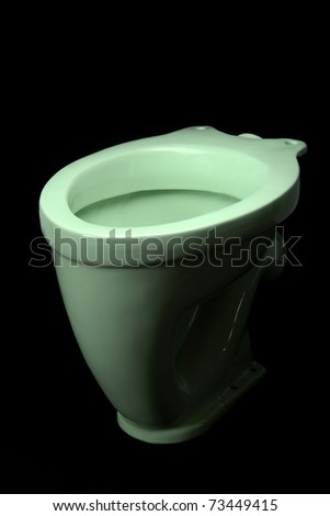 The light green toilet bowl, isolated on black background - stock photo