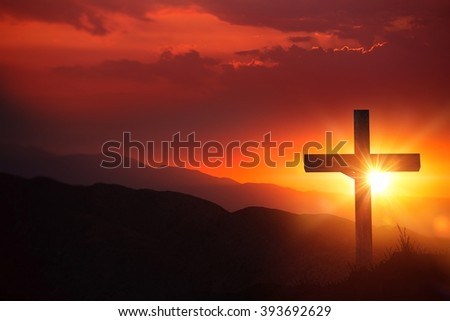 The Light of Christ Old Wooden Crucifix on the Desert During Scenic Sunset. Christian Cross Sunset Background. - stock photo