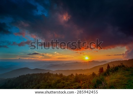 The light over the Appalachian Mountains along the Blue Ridge Parkway in Western North Carolina paints the sky with the setting sun. - stock photo