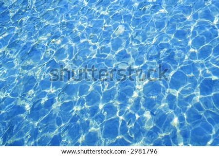The light reflected in the swimming pool water