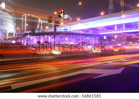 the light trails on the busy streets background in shanghai ,China - stock photo