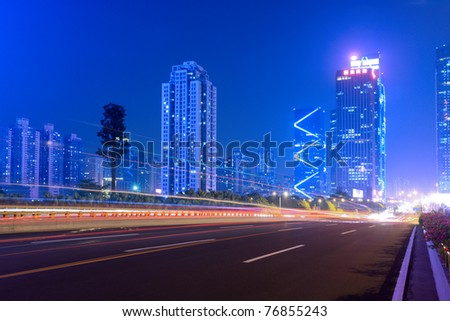 the light trails on the highway in shenzhen city,China - stock photo