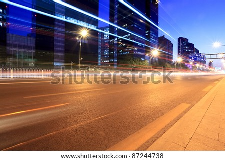 the light trails on the modern building background in beijing,China - stock photo