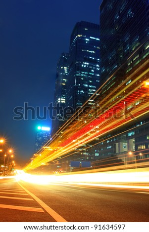 the light trails on the modern building background in  china