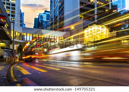 the light trails on the modern building background in Hong Kong China