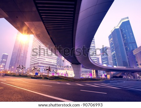 the light trails on the modern building background in shanghai c - stock photo