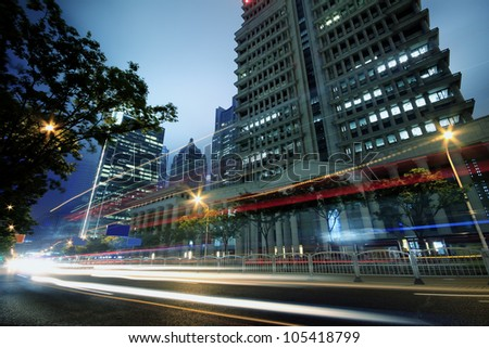 The light trails on the modern buildings background in shanghai china - stock photo