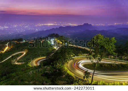 The light trails on the moutain street in morning, Thailand