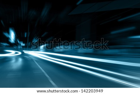 the light trails on the street - stock photo