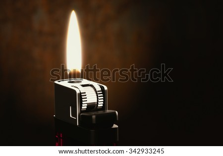 The lighters in the dark room 3d rendering. - stock photo