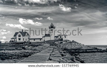 The lighthouse and the living quarters are shown in this image from Gloucester, MA. - stock photo