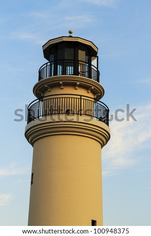 The lighthouse at sunset. - stock photo