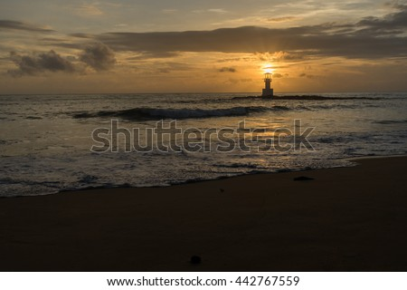 The lighthouse in sun set view of NANG THONG beach in Khao Lak, Thailand.